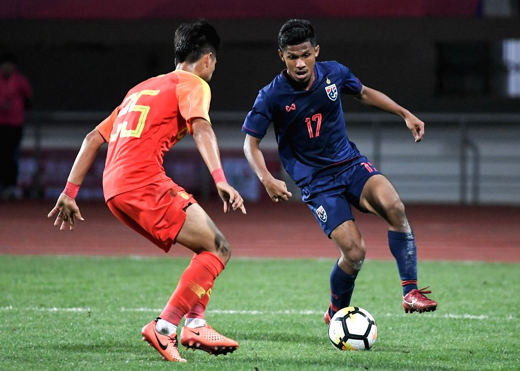 CHENGDU, May 27, 2019 - Thailand's Thana Isor (R) vies for the ball during the match between Thailand U18 national team and China U18 national team at Panda Cup International Youth Football ...