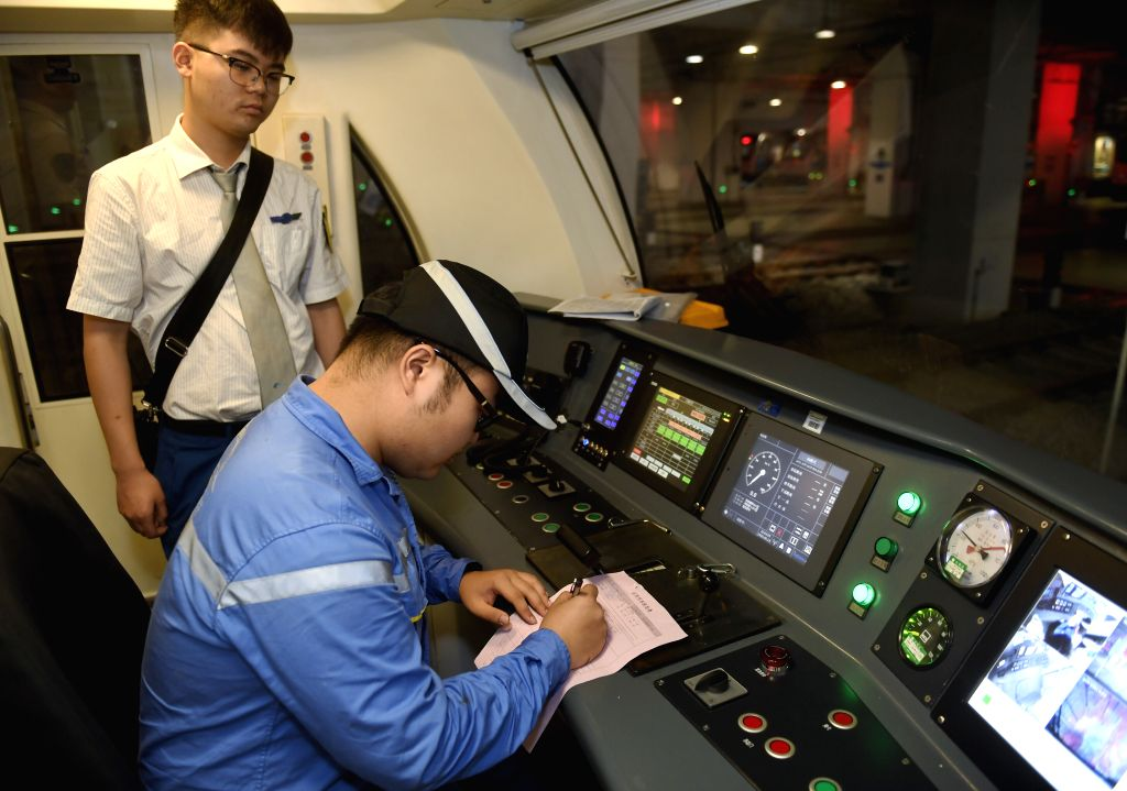 CHENGDU, Sept. 14, 2019 - A maintenance worker carries out the handover of the train with a driver of subway Line 1 in Chengdu, southwest China's Sichuan Province, Sept. 13, 2019. Workers of subway ...