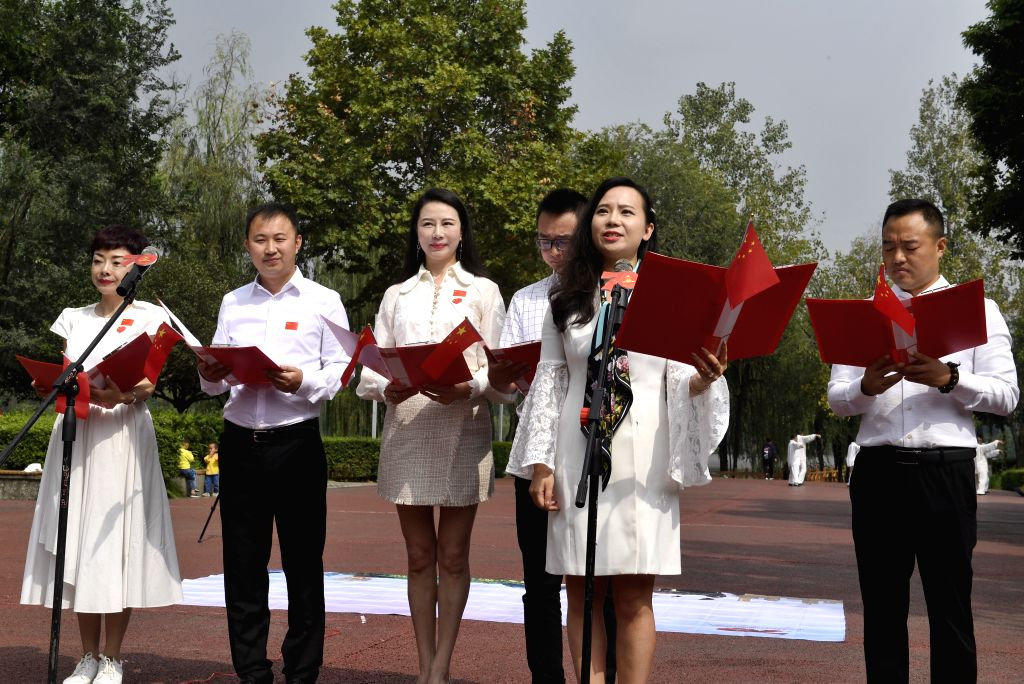 CHENGDU, Sept. 27, 2019 - People recite a poem during a theme event celebrating the 70th anniversary of the founding of the People's Republic of China (PRC) at Chengdu International Cultural Art ...