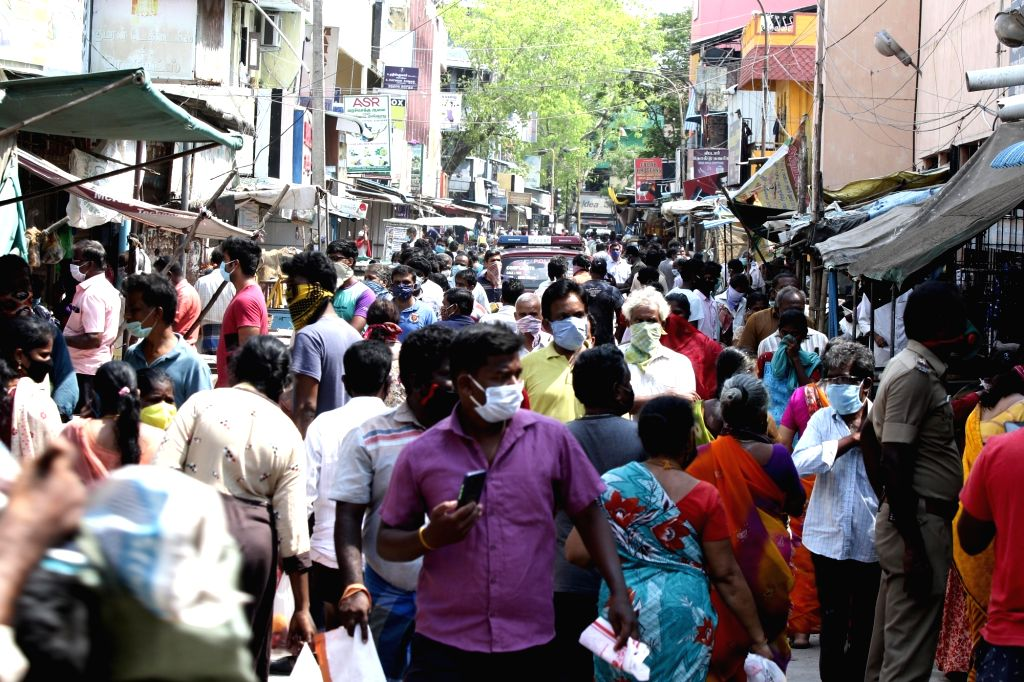 Chennai: A crowded Chennai market with people violating social distancing orders during the extended nationwide lockdown imposed to mitigate the spread of coronavirus; on April 25, 2020. (Photo: IANS)