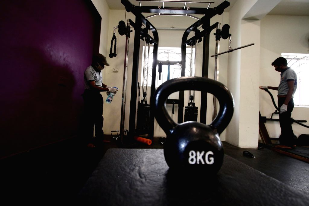 Chennai: A gym being sanitised as it gears up to re-open amid COVID-19 pandemic in Chennai on Aug 6, 2020. (Photo: IANS)