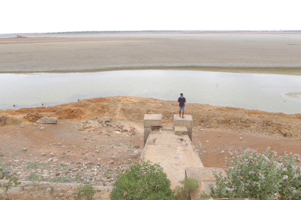 Chennai: A view of the dried out Puzhal reservoir on the outskirts of Chennai, on June 20, 2019. Chennai and several other places in Tamil Nadu are suffering from water shortage. The ground water levels too have gone down owing to lack of rains. (Pho