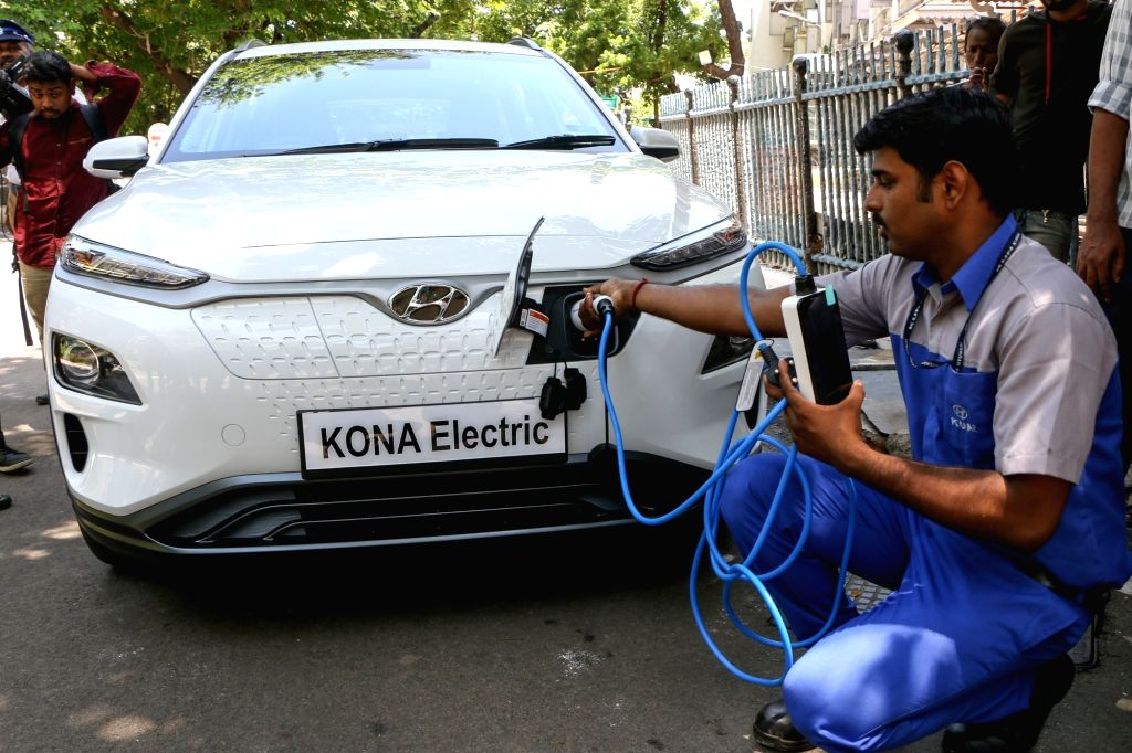 Chennai: A worker demonstrates the usage of electrical vehicle (EV) charging cable at the flagging off ceremony of the Hyundai Motor India Ltd's electric sports utility vehicle (SUV) KONA Electric at the Tamil Nadu secretariat, in Chennai on July 24,