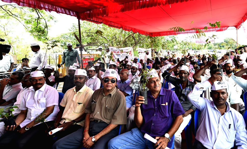 Aam Aadmi Party (AAP) workers stage a demonstration against the land acquisition ordinance in Chennai, on April 22, 2015.