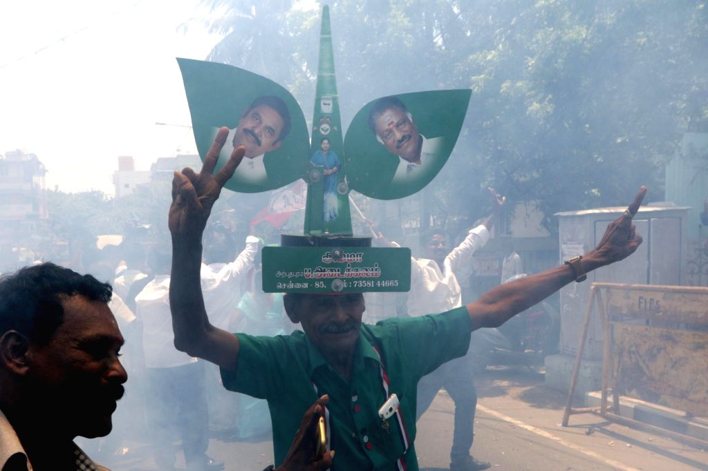 Chennai: AIADMK workers celebrate after the party was leading in the 8 Assembly constituencies as per the initial counting trends available for the by-elections held for 22 seats in Tamil Nadu; in Chennai on May 23, 2019. (Photo: IANS)
