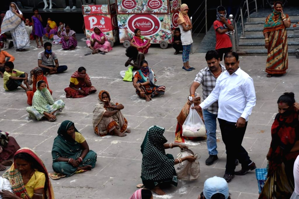 Chennai, April 19 (IANS) Tamil Nadu Bharatiya Janata Party (BJP) chief L. Murugan, here on Sunday, distributed `ModiKit' relief materials to unorganised workers and other poor people.
