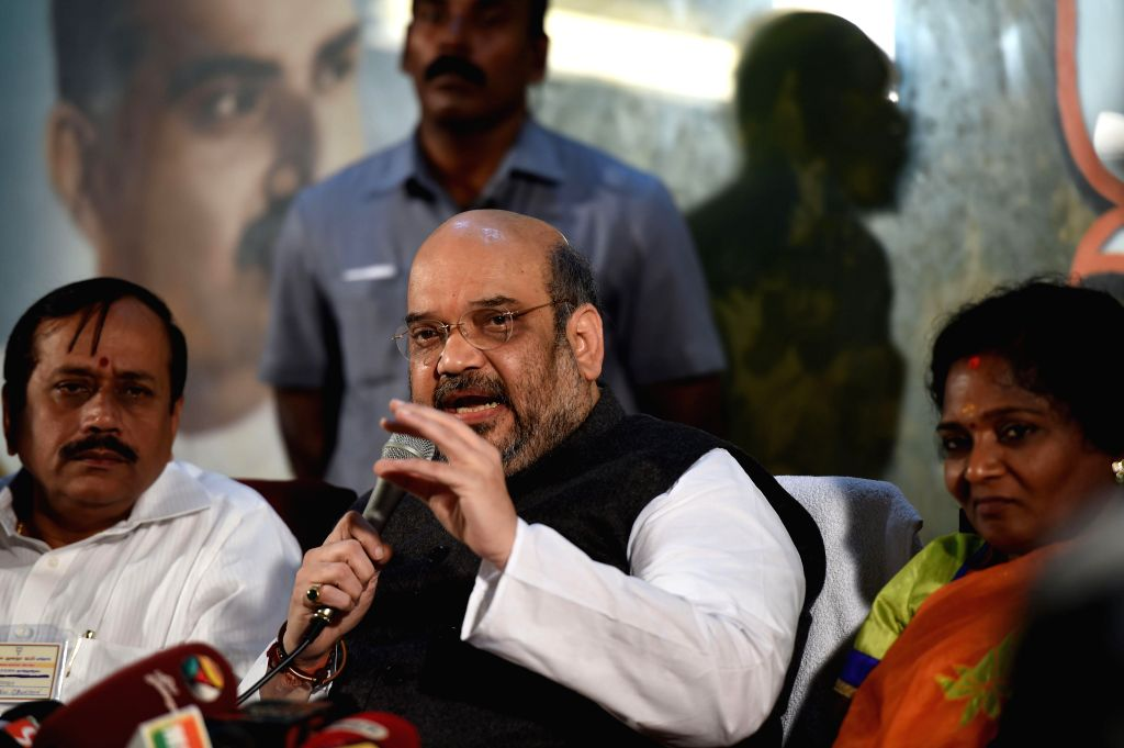 BJP chief Amit Shah addresses a press conference in Chennai, on Dec 21, 2014.