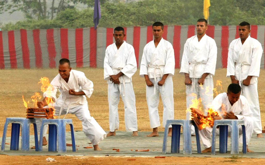 Cadets display their skills during the Combined display - a prelude to the Passing Out Parade - organised at Officers Training Academy (OTA), in Chennai on March 13, 2015.