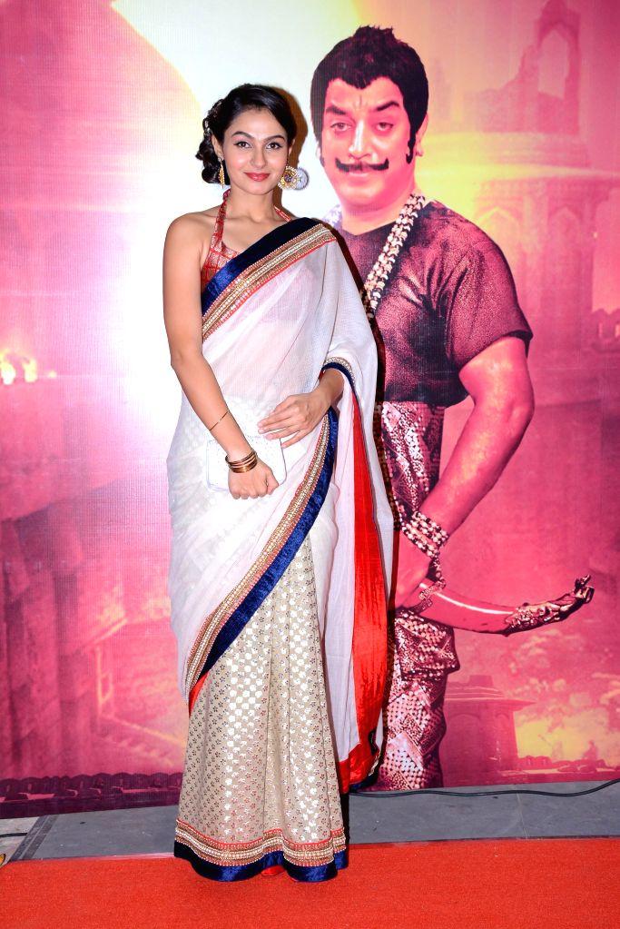 Chennai: Actor Pooja Kumar at the audio launch of upcoming multilingual film `Uttama Villian`. - Pooja Kumar