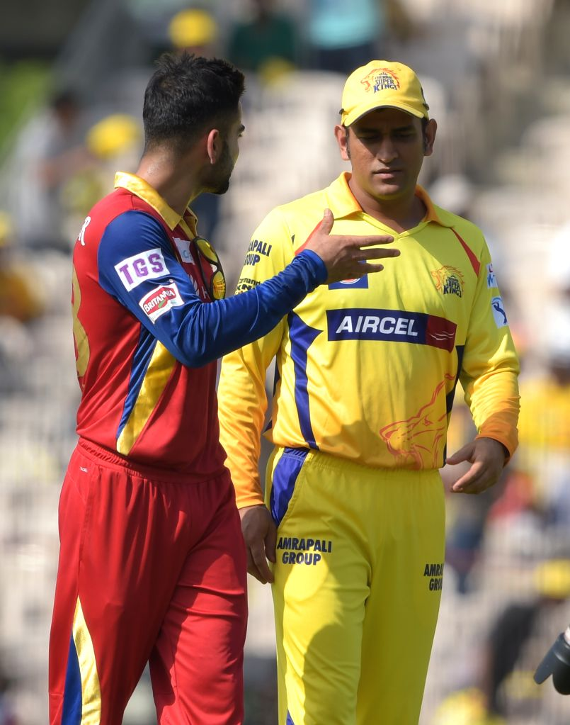 Chennai Super Kings captain MS Dhoni and Royal Challengers Bangalore captain Virat Kohli during an IPL 2015 match at M. A. Chidambaram Stadium in Chennai on May 4, 2015. - MS Dhoni and Virat Kohli