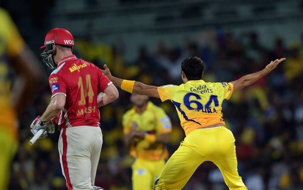 Chennai Super Kings celebrate fall of a wicket during an IPL-2015 match between Chennai Super Kings and Kings XI Punjab at MA Chidambaram Stadium, in Chennai, on April 25, 2015.