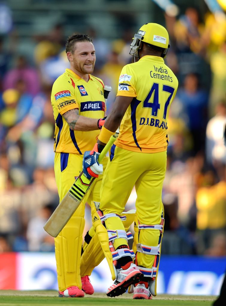 Chennai Super Kings (CSK) player Dwayne Bravo congratulates teammate Brendon McCullum after completing his century during an IPL-2015 match between Chennai Super Kings (CSK) and Sunrisers ...