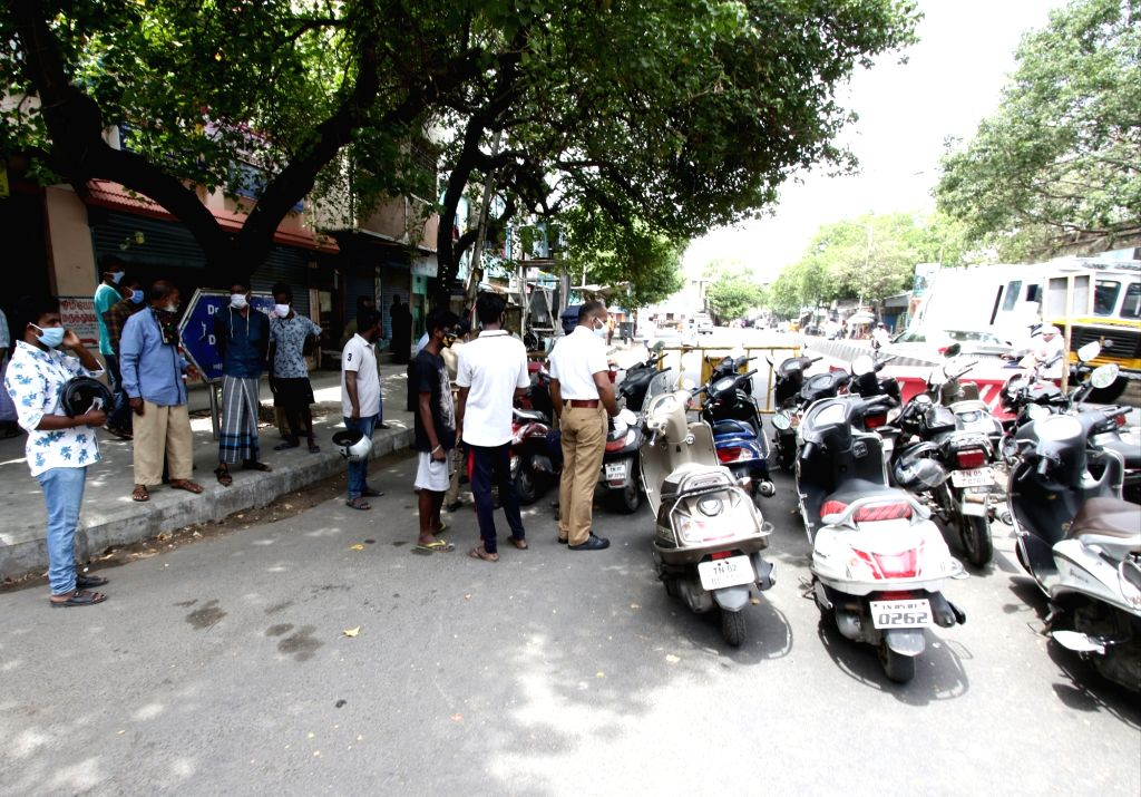 Chennai: Commuters being intercepted by the police during a 12-day intensified lockdown imposed to prevent COVID-19 pandemic, in Chennai on June 23, 2020. (Photo: IANS)