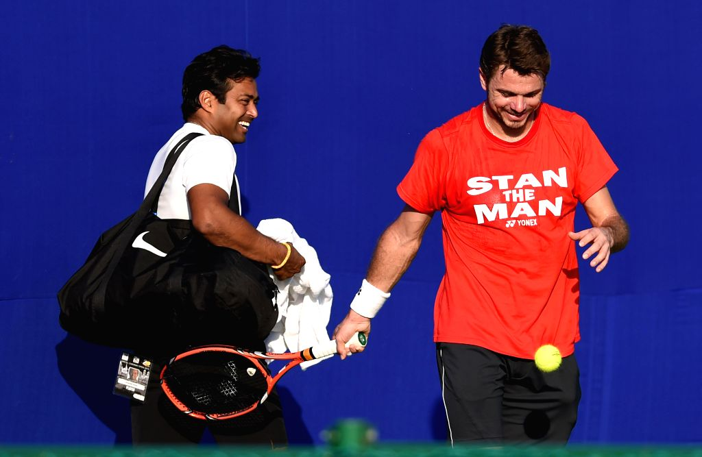 Defending tennis champion and World No 4 Stanislas Wawrinka of Switzerland with Indian's Leander Paes during a practice session ahead of  ATP Chennai Open 2015 in Chennai on Jan 5, 2015.