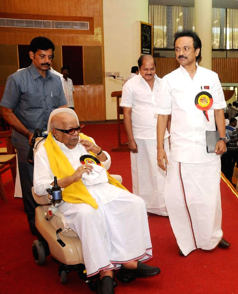 DMK chief M Karunanidhi and DMK treasurer M K Stalin arrive to attend party's executive committee meeting at Kalainger Arangam in Chennai, on March 5, 2015.