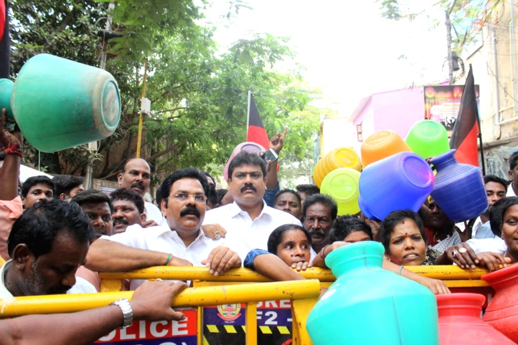 Chennai: DMK workers along with locals stage a demonstration against the scarcity of water in Chennai, on June 21, 2019. (Photo: IANS)