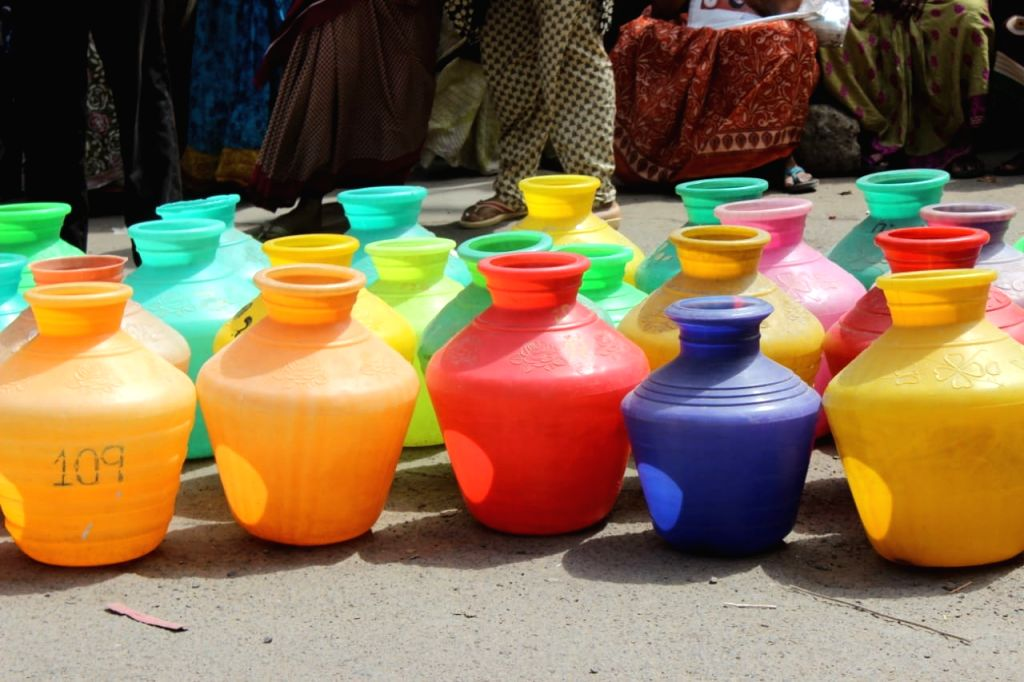 Chennai: Empty pots displayed by locals during a demonstration to protest against the scarcity of water in Chennai, on June 21, 2019. (Photo: IANS)