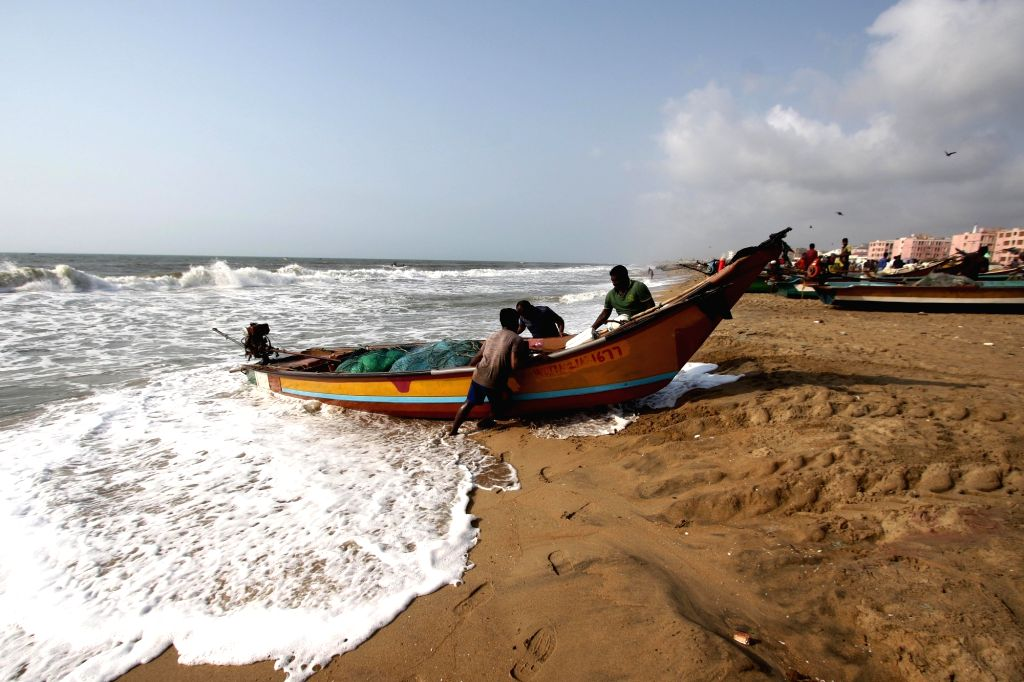 Chennai: Fishermen push back a boat at a Chennai beach on the seventh day of the fourth phase of the nationwide lockdown imposed to mitigate the spread of cornavirus, on May 24, 2020. (Photo: IANS)