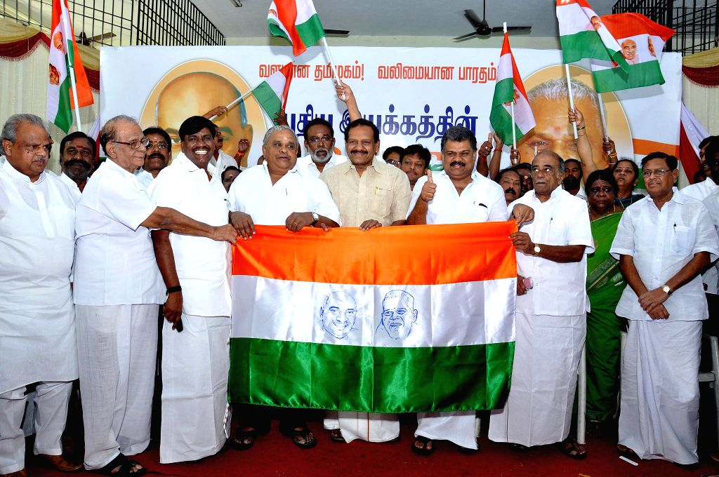 Former Congress leader G K Vasan unveils his party flag in Chennai, on Nov 26, 2014.