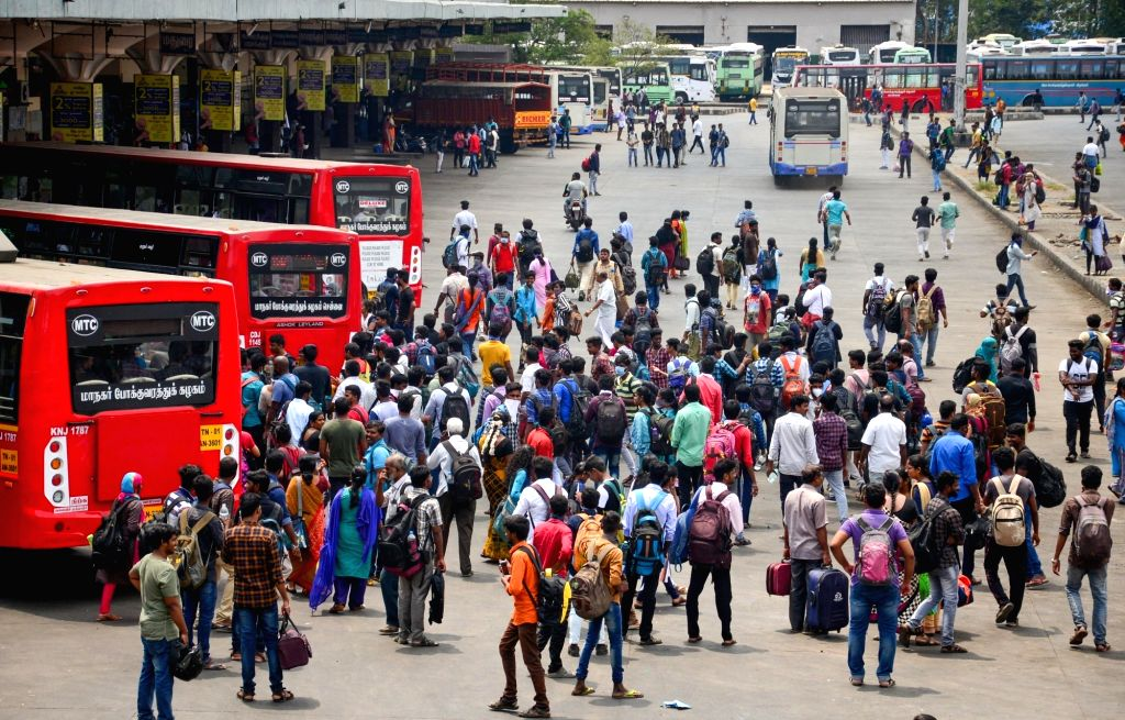 Chennai: Immigrant workers returning back home face difficulty in getting appropriate transportation in the absence of inter-city buses, during complete lockdown in the country in a bid to curtail the spread of coronavirus, in Chennai on March 23, 20