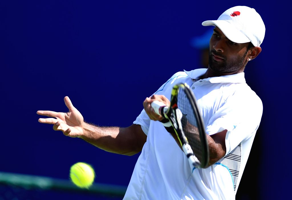 Indian tennis player Jeevan Nedunchezhiyan in action against Indian tennis player Lakshit Sood during the qualifier match of ATP Chennai Open 2015 in Chennai on Jan. 3, 2014.
