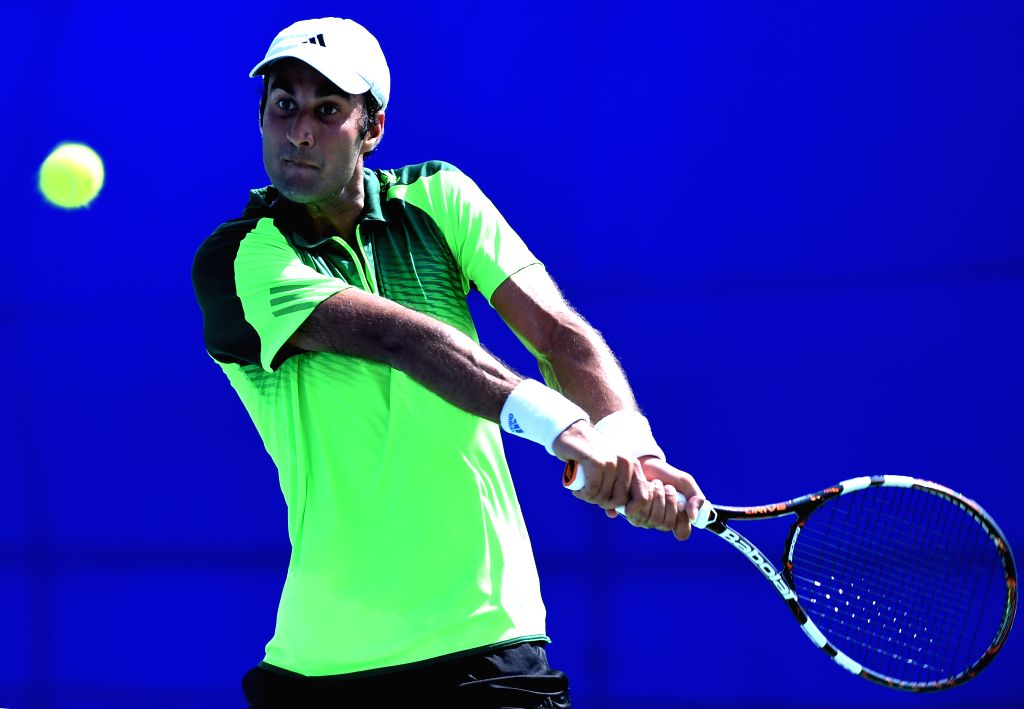 Indian tennis player Yuki Bhambri in action against Indian tennis player Sidharth Rawat during the qualifier match of ATP Chennai Open 2015 in Chennai on Jan. 3, 2014.