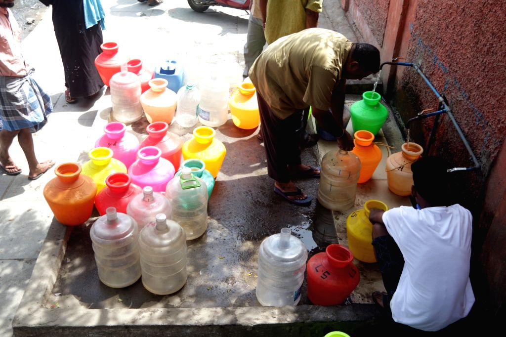 Chennai: Locals gather to collect drinking water at a water distribution point amid ongoing water crisis in Chennai, on June 19, 2019. Chennai and several other places in Tamil Nadu are going through water crisis. The reservoirs -- Cholavaram (full c