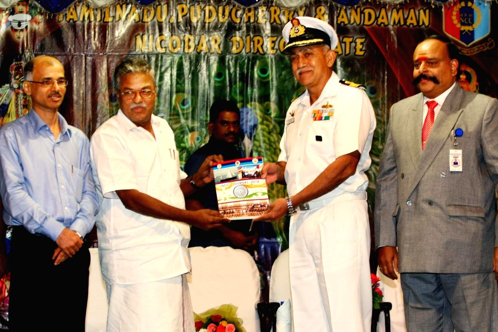 Minister for Sports and Youth Welfare Government of Tamil Nadu S Sundararaj releases a souvenir on NCC Day at DG Vaishnav College in Chennai on Nov 24, 2014.