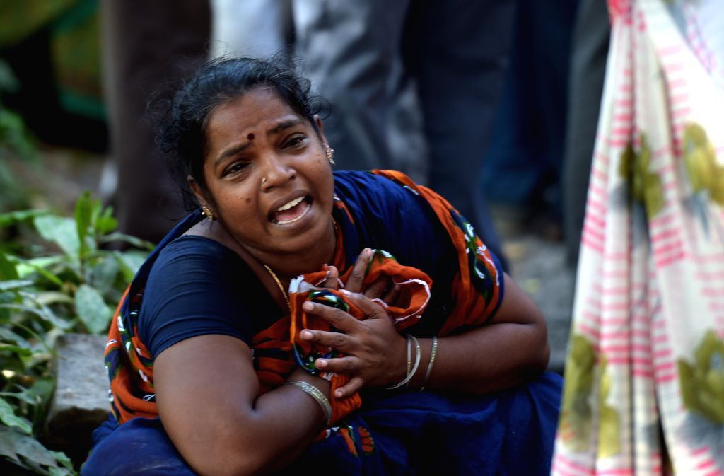 Mother of one of the two school girls were crushed to death after a 9-feet wall collapsed on them at their school campus in Besant Nagar, Chennai on April 13, 2015.