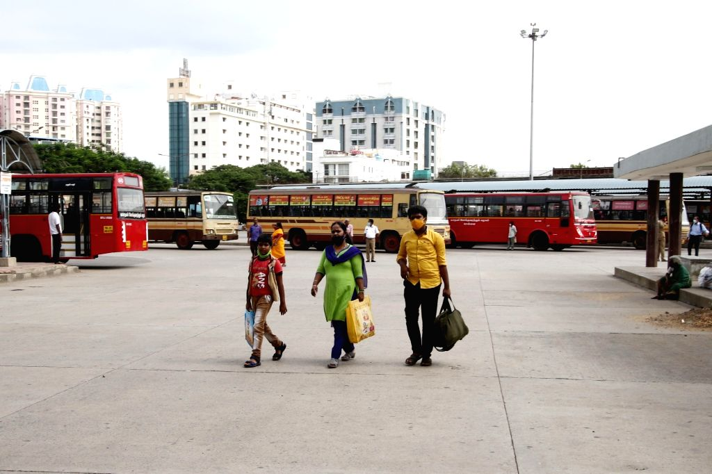 Chennai: Passengers arrive at a bus depot to board buses to their respective destinations after the Tamil Nadu Government permitted the resumption of public transport services across the state, in Chennai on Sep 1, 2020. (Photo: IANS)