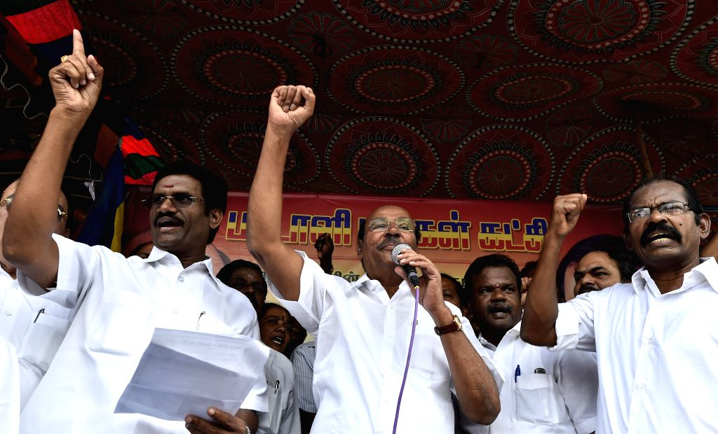 Pattali Makkal Katchi (PMK) founder and president Dr. S Ramadoss with other party leaders during a protest rally against the central government`s land acquisition ordinance, at ...