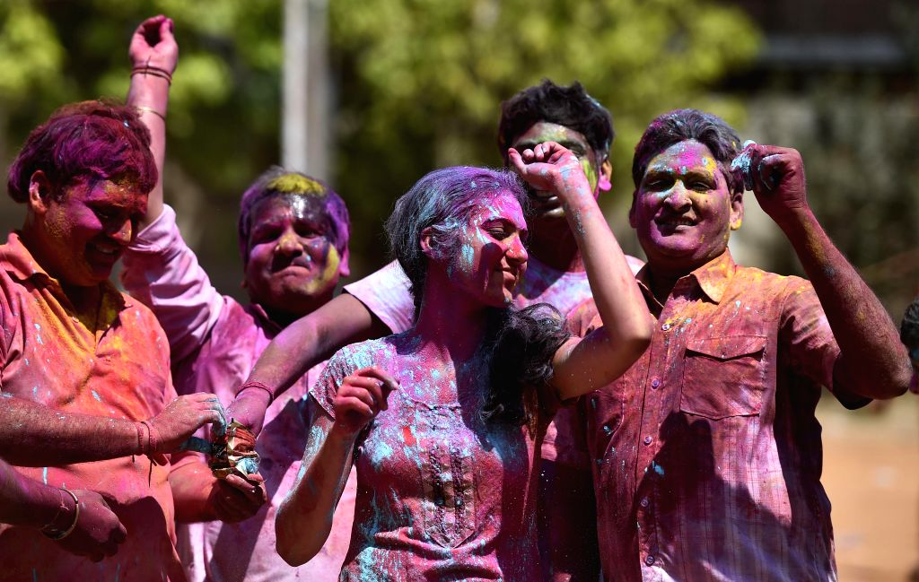 People celebrate Holi in Chennai on March 6, 2015.
