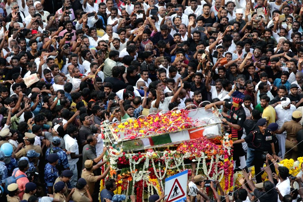 :Chennai: People in large numbers participate in the funeral procession of DMK patriarch and former Tamil Nadu Chief Minister M. Karunanidhi, in Chennai on Aug 8, 2018. Karunanidhi was buried ...