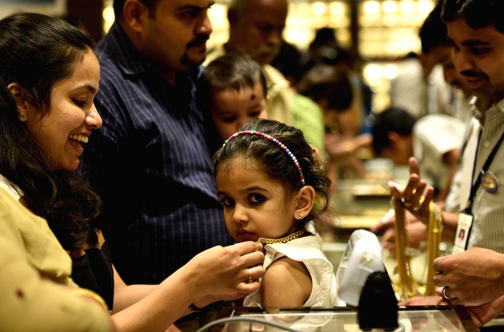 People shopping at a jewellery shop on Akshaya Tritiya in Chennai on April 21, 2015.