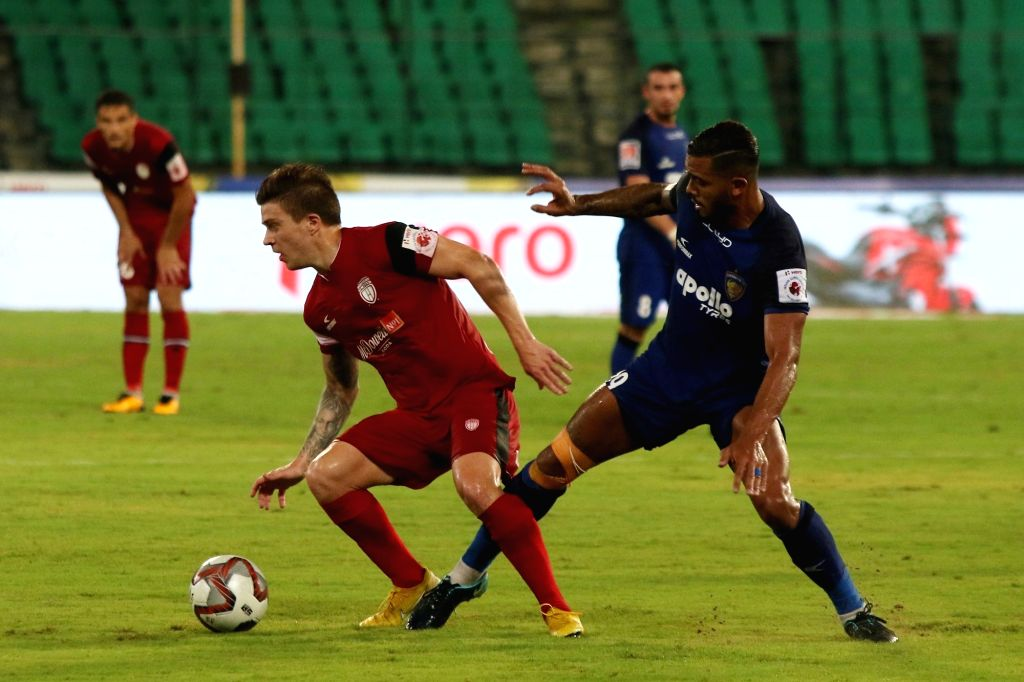 :Chennai: Players in action during an ISL 2018 match between Chennaiyin FC and NorthEast United FC at Jawaharlal Nehru Stadium in Chennai on Oct 18, 2018. (Photo: IANS).