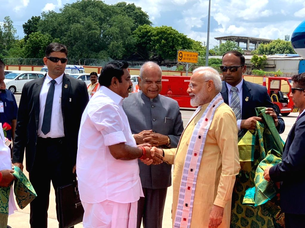 Chennai: Prime Minister Narendra Modi being welcomed by Tamil Nadu Governor Banwarilal Purohit and Chief Minister Edappadi K. Palaniswami on his arrival in Chennai, ahead of an Informal Summit between India and China, on Oct 11, 2019. (Photo: IANS/PI - Narendra Modi