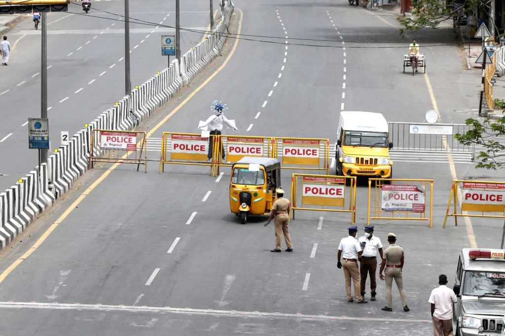 Chennai: Security beefed up at a barricaded Chennai road with a 'Coronavirus scarecrow' installed to create awareness among people during a 12-day intensified lockdown imposed to prevent COVID-19 pandemic, on June 21, 2020. (Photo: IANS)