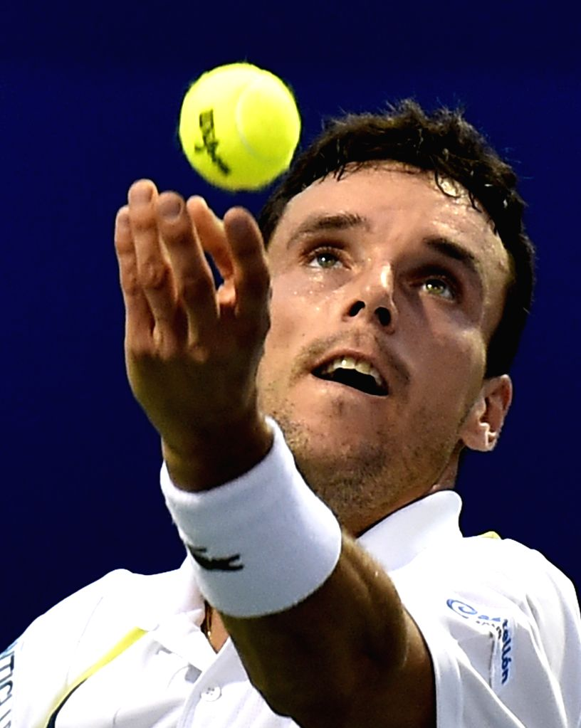 Spanish tennis player Roberto Bautista Agut in action against Slovenian tennis player Aljaz Bedene during the semi-final match of ATP Chennai Open 2015 in Chennai on Jan 10, 2015.