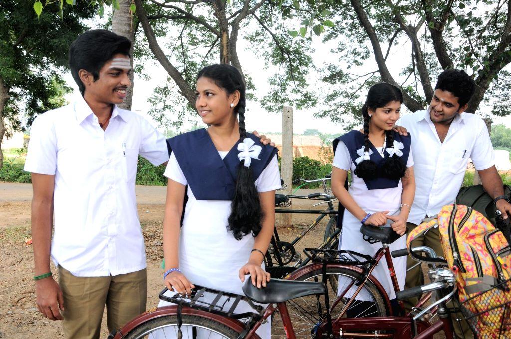 Stills from Tamil film `Kamar Kattu`.