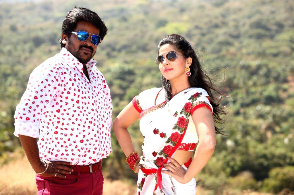 Stills from Tamil film `Naalu Peru Naalu Vithama Pesuvanga`.