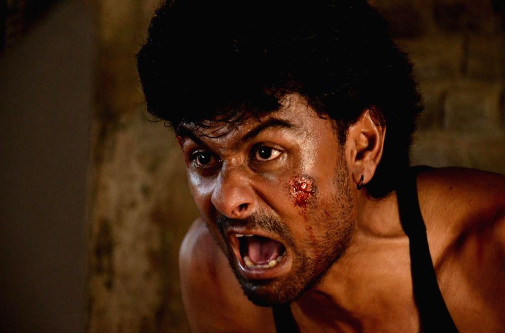 Stills from Tamil film 'Vizhi Moodi Yosithal'.