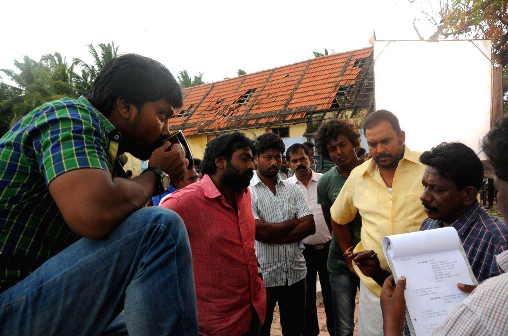 Stills from upcoming Tamil film `Vanmam`.