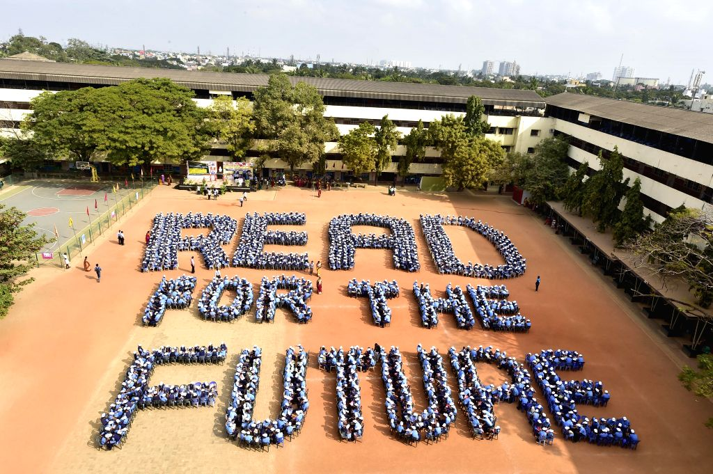 """Students make a formation in the shape of """"READ FOR FUTURE"""" at a private school in Chennai on Jan. 31, 2015."""