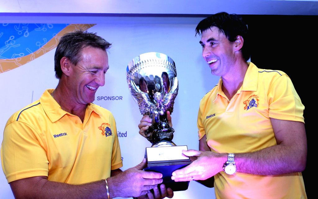 "Chennai Super Kings coach Stephen Fleming with bowling coach Andy Bichel unveiling the trophy of ""Chennai Super Kings Super Cup"" in Chennai on Feb. 1."