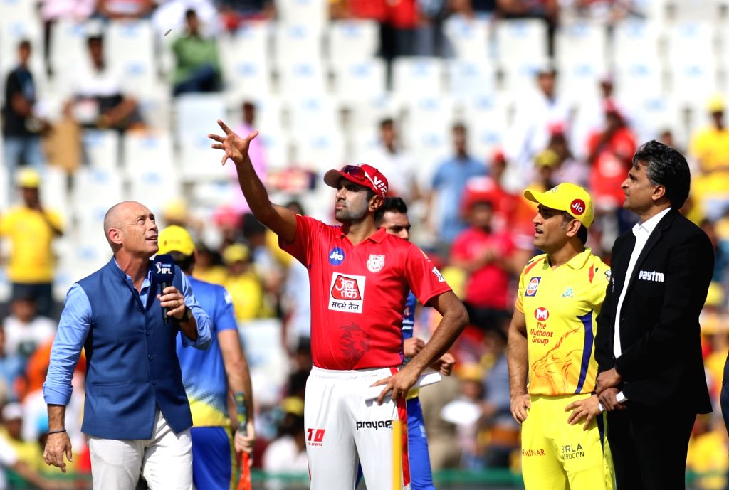 Chennai Super Kings' skipper MS Dhoni and Kings XI Punjab's skipper R Ashwin during the toss ahead of the 55th match of IPL 2019 between Chennai Super Kings and Kings XI Punjab at Punjab ... - MS Dhoni