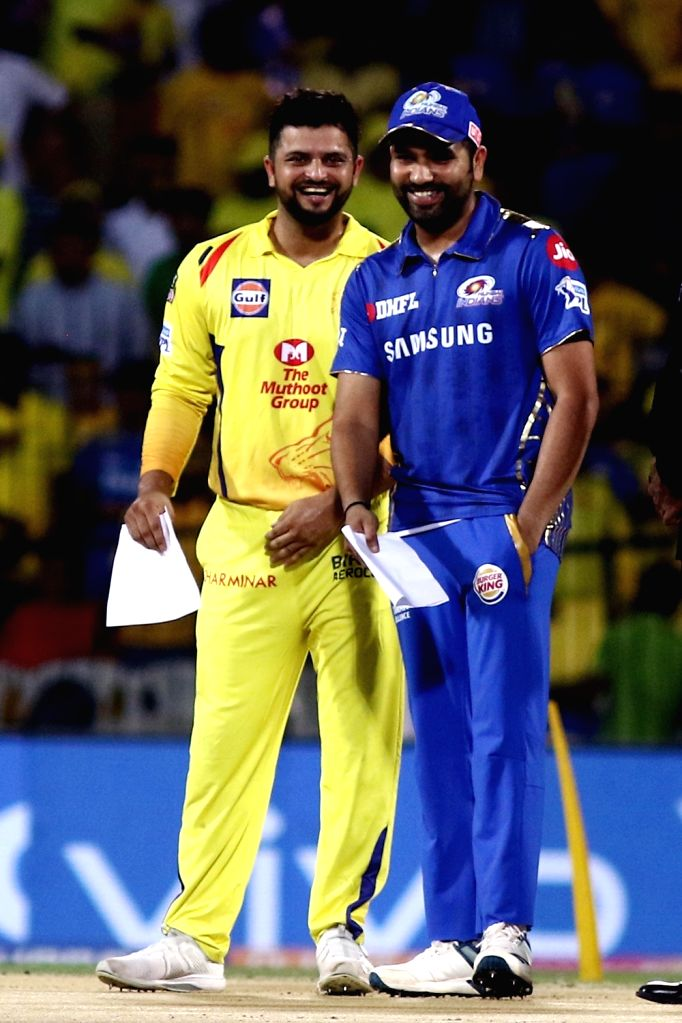 Chennai Super Kings' skipper Suresh Raina and Mumbai Indians' skipper Rohit Sharma during the toss ahead of the 44th match of IPL 2019 between Mumbai Indians and Chennai Super Kings at MA ... - Rohit Sharma
