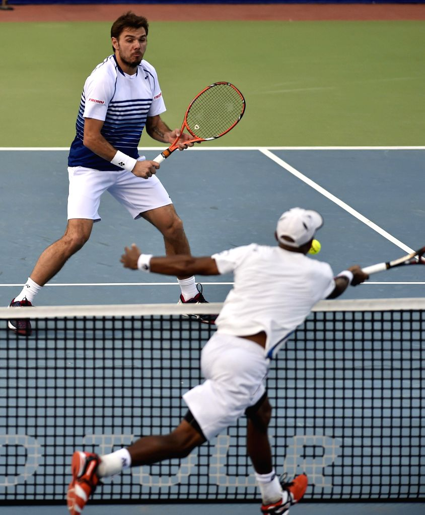 Swiss player Stan Wawrinka and Spanish player Roberto Bautista Agut (not in picture) in action against USA player Nicholas Monroe and Swedish Johan Brunstrom during the first round of men`s .