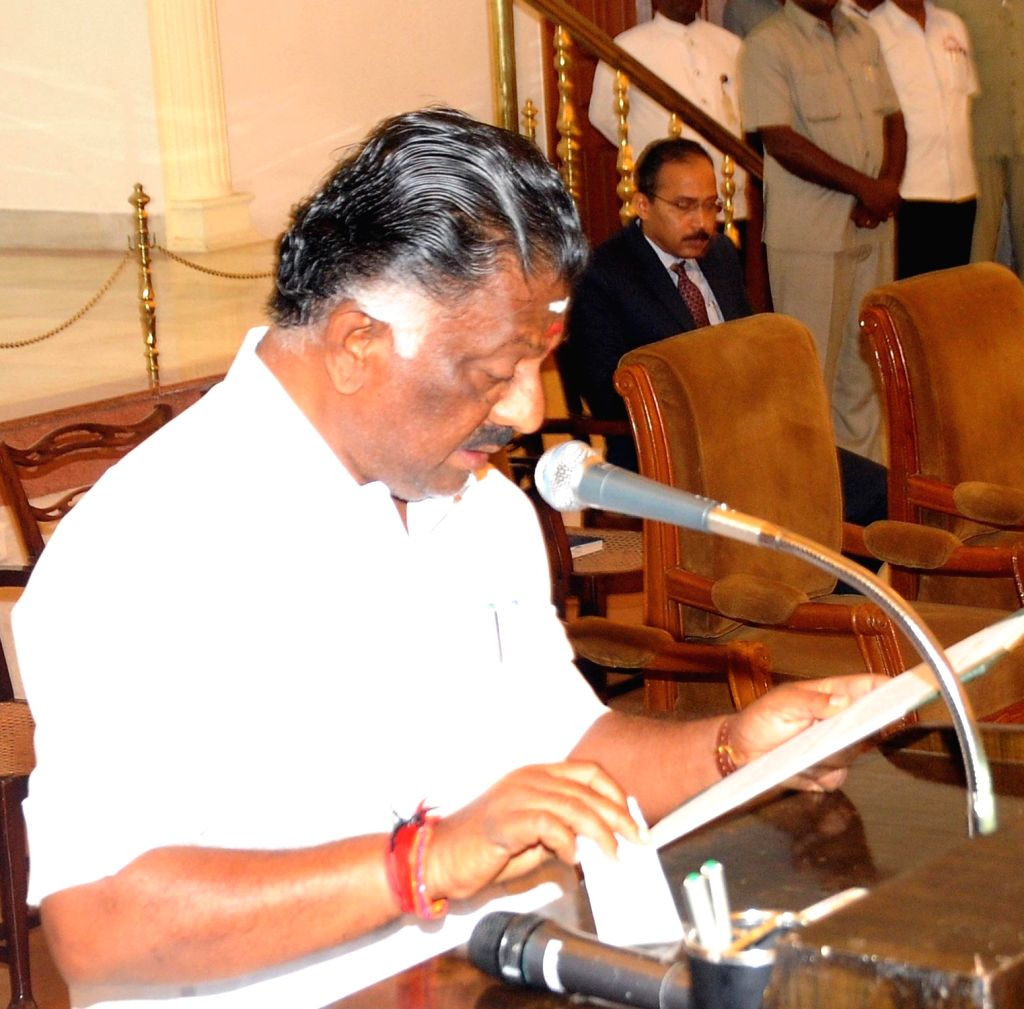 Chennai: Tamil Nadu Finance Minister and AIADMK leader O Panneerselvam swears-in as the new Chief Minister of Tamil Nadu after the death of AIADMK supremo and Tamil Nadu Chief Minister J Jayalalithaa. (File Photo: IANS) - J Jayalalithaa