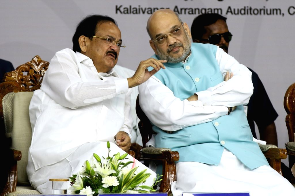 Chennai: Vice President M Venkaiah Naidu and Union Home Minister Amit Shah during an event to release the Book 'Listening, Learning & Leading' published by the Ministry of Information and Broadcasting, in Chennai on Aug 11, 2019. (Photo: IANS) - Amit Shah and M Venkaiah Naidu