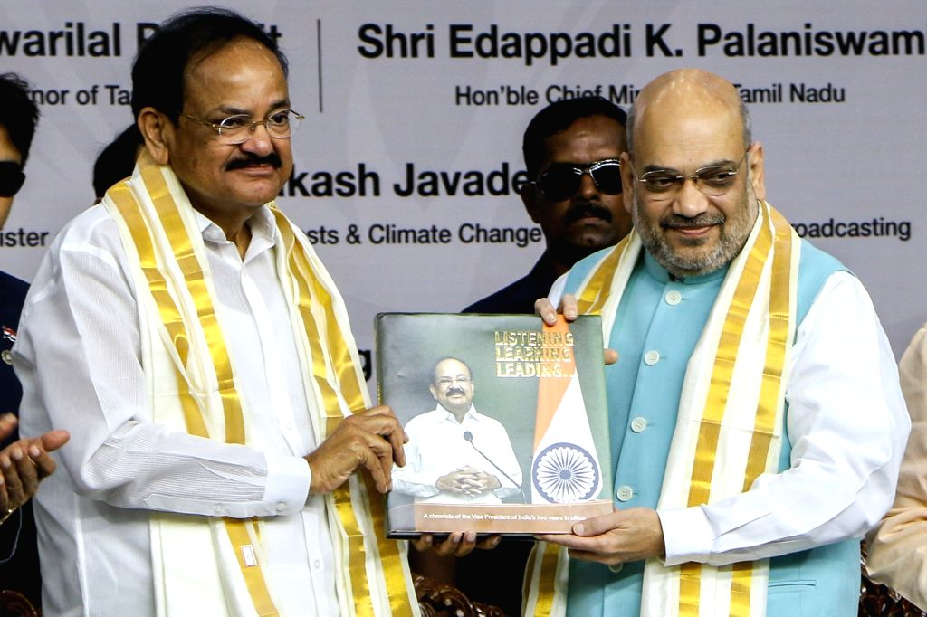 Chennai: Vice President M Venkaiah Naidu receives the first copy of the Book 'Listening, Learning & Leading' from the Union Home Minister Amit Shah, published by the Ministry of Information & Broadcasting, on the occasion of completing two years in o - Amit Shah and M Venkaiah Naidu